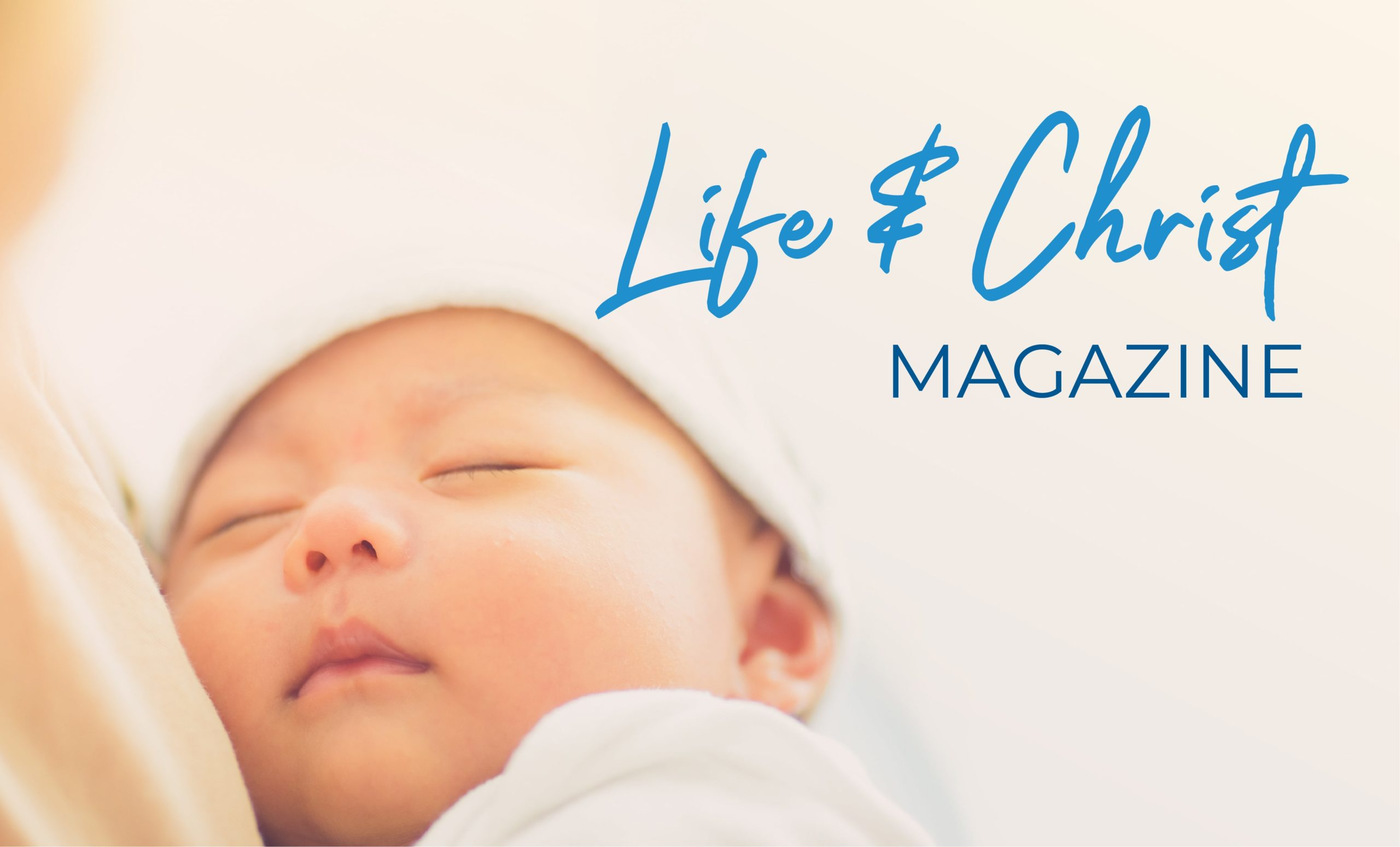 Life & Christ Magazine Banner image of mother holding baby in soft warm light